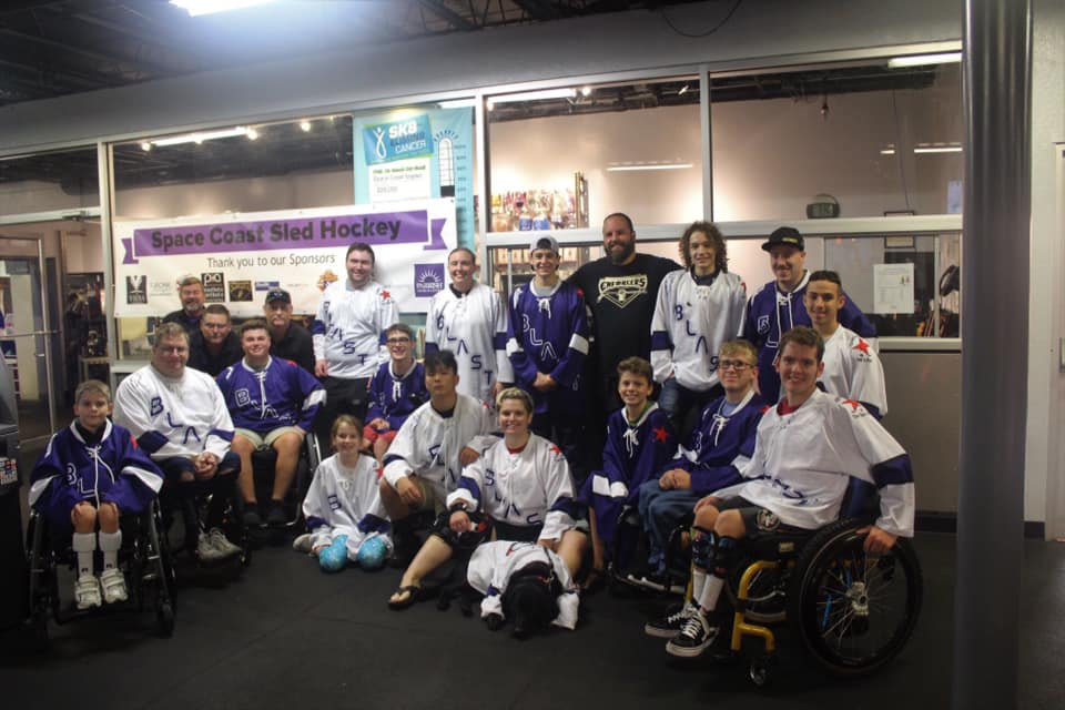 Space Coast Sled Hockey Team Photo with Sponsor Banner